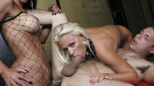Two trannies fuck the slave